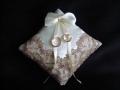Белая подушечка с декором из вышивки